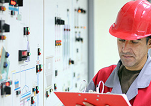 indicator on power station control panel with person inspecting