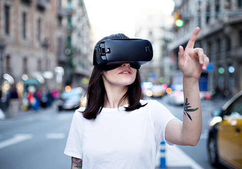 girl with vr goggles walking in the street